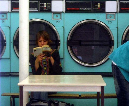 No one cares about your dirty laundry. Not this chick. She's reading a book. (SOURCE: Gideon's Flickr photostream)